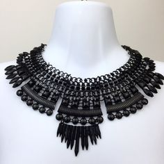 Black of Rochester Spiky Statement Necklace This piece is very strong and will definitely send a message. Combine with ruffle cold shoulder maxi dress.  Lobster clasp closure. Sits on collar bones.  Unnamed Opulence Jewelry Necklaces