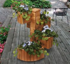 Cedar Spiral Planter Woodcrafting Plans Create a colorful cascading display with your favorite flowers in this attractive planter. #diy #woodcraftpatterns