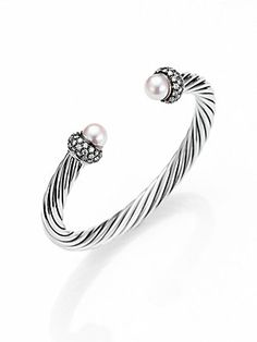 David Yurman Pearl, Diamond & Sterling Silver Cuff Bracelet...So purdy.... was torn between this one when the man got me my pretty pearl and diamond cuff! This one looks awesome with a few other smaller cuffs!