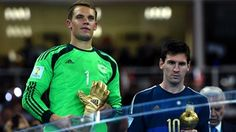 Manuel Neuer of Germany receives the Golden Glove trophy and Lionel Messi of Argentina receives the Golden Ball