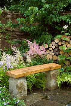 Stone bench on patio in backyard garden, with flowers, ferns, hosta.  I'm really pinning this so I remember to put in some pink astilbe this year! :)