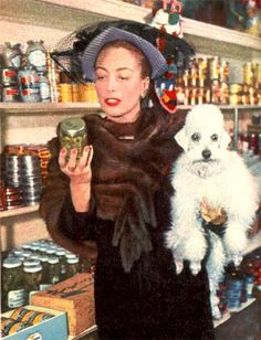 Joan checking out a jar of pickles, and maybe shopping for dog food, as her pooch looks hungry! dog also looks kind of spooked Hollywood Heroines, Hollywood Cinema, Vintage Hollywood, Hollywood Actresses, Classic Hollywood, Hollywood Homes, Hollywood Glamour, Hollywood Stars, Poodles