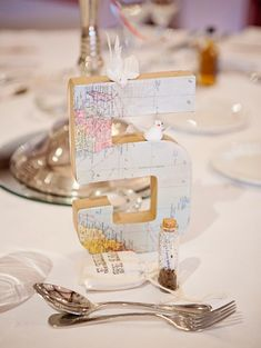 Chantal Lachance-Gibson Photography/Wedding Photographers Scotland/ Wedding Photographers Destination/Wedding Reception Travel Theme Table Numbers