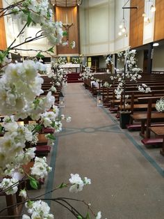 Posy Barn white blossom trees in the church aisle