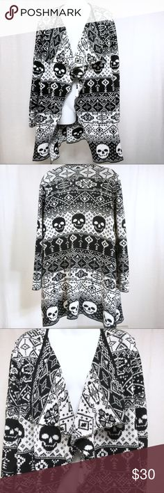TORRID Black White Skull Print Cardigan Sweater 2 This sweater is in fairly good condition. It has been pre-loved. There are a couple of snags on it. One is clearly shown in one of the pictures. I would normally pull them through, but I wanted to disclose that so you know. torrid Sweaters Cardigans