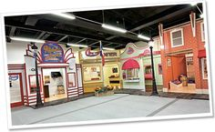 One of our commercial playhouse villages. A whole town to explore! Lilliput Play Homes