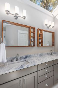The subtle brown undertones in our Creek Stone cabinetry make it the perfect match for wood accents, like these bathroom mirrors. Gray Cabinets, Kitchen Cabinets, Discount Cabinets, Bathroom Mirrors, Wood Accents, Grey Paint, Cabinet Doors, Perfect Match, Double Vanity