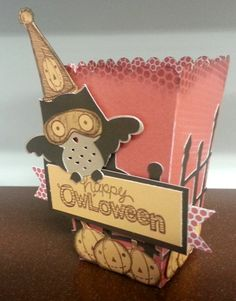 this cute little popcorn box is perfect for storing your favorite Halloween treats.  visit the blog for tips on how to make this yourself