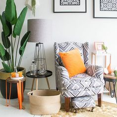 We love a good monochrome palette to be able to alternate the colour pop easily as the season and our mood changes // @designtwins pot $250, artificial palm leaf $252, orange side table $149.95, black side table $99.95, large table lamp $229.95, basket $59.95, occasional chair and foot stool $1250, orange cushion $59.95, round floor rug $299.95, black industrial stool $139.95 and home accessories from $24.95.