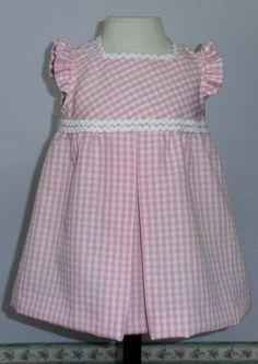 Vestido para bebe niña en vichy a cuadros rosa y blanco combinado con piquillo blanco.