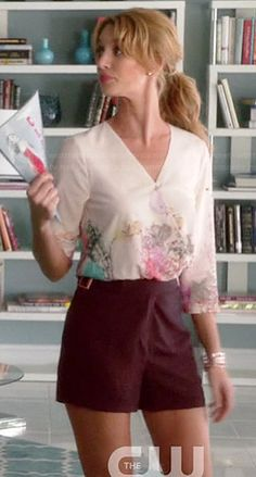 Petra's floral wrap blouse and burgundy shorts on Jane the Virgin.  Outfit Details: http://wornontv.net/40642/ #JanetheVirgin
