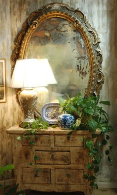 Ornate antique mirror pairs perfectly with simple chest of drawers