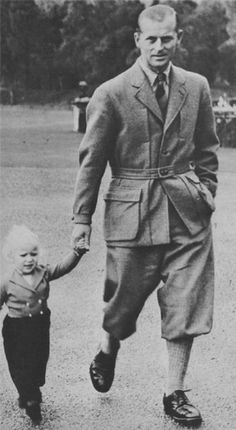 Prince Philip holding princess Anne's hand, wearing a Norfolk Jacket,  in 1952