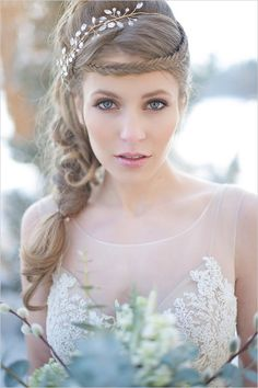Stunning fairytale bridal look with braid and hair piece. Hair: Cassandra Rose Makeup: Makeup Madame ---> http://www.weddingchicks.com/2014/05/09/magical-winter-wedding-ideas/