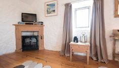 Polmina, Bosigran Organic Farm, Cornwall. Antique pine furniture, stripped floorboards and whitewashed walls enhance the attractive decor http://www.organicholidays.com/at/3358.htm