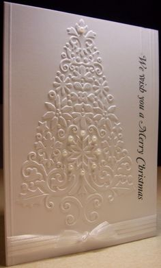 Cuttlebug Embossing Folder Lace Tree. What caught my attention in this design was the detail in the tree. Really nice design, very well done. Gives me ideas for the holidays.