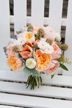 dusty miller, scabiosa pods, juliet roses, garden roses, and eucalyptus leaves in this beautiful bouquet
