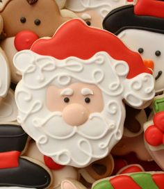 DIY Decorated Santa Cookie from a turkey cookie cutter.. how smart!!  (shows how to make these)