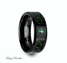 High Quality in Style Women's and Men's Ceramic Rings   Personalized Black Ceramic Ring with Black and Green Carbon Fiber and Green Emerald Setting - 8mm  Specification Carbide Wedding Bands *FINISH POLISHED *THICKNESS 2.0 MM - 2.2 MM *WEIGHT 6 - 13,5 GRAMS * COMFORT FIT AND SIZING *SIZES AVAILABLE 6-14 US INCLUDING 1/2 SIZES *DURABLE *HYPOALLERGENIC, COBALT - FREE *ITEM NUMBER 3904   Engraving: If you want your personal note to be engraved on the ring you are ordering, please let me know wh...