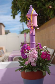 Very simple Rapunzel centerpiece-- Dollar Tree birdhouse and a table leg or…