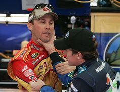 Carl Edwards puts a choke hold on Kevin Harvick during a scuffle in the Nationwide Series garage at Charlotte Motor Speedway in 2008. Edwards was mad over a note that Harvick left him after Edwards caused a crash at Talladega. (AP Photo)