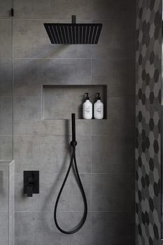 Matte Black Accents Add Sophistication To This Grey And White Bathroom : In this modern bathroom, the shower has a matte black rainfall shower head and a hand held shower head, as well as a tiled built-in shelf. Gray And White Bathroom, Black And White Tiles, Bathroom Grey, Rain Shower Bathroom, Tile Shower Niche, Bohemian Bathroom, Bathroom Mat, Bathroom Plants, Bad Inspiration