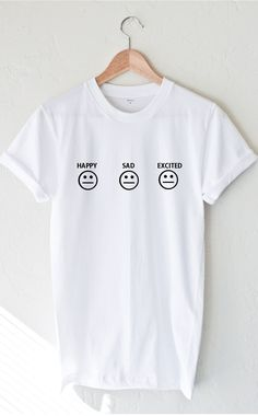 "- Description Details: Soft, unisex fit t-shirt by NYCT Clothing with print featuring 'Happy Sad Excited' in white. Measurements: (Size Guide) S: 34"" bust, 27"" length M: 40"" bust, 29"" length L: 43"" bu"