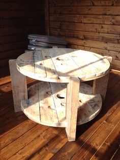 Table made from a recycled cable drum and decking from Brighton pier.