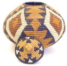 Zulu basket | Made from coil grass, Ilala plam leaves and natural dyes.   The geometric pattern is of special significance in the Zulu culture.