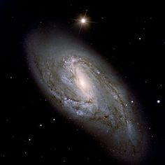 NGC 3627, also known as Messier 66, i.e. it is the 66th object in the famous catalogue of nebulae by French astronomer Charles Messier (1730 - 1817). It is located in the constellation Leo (The Lion). NGC 3627 is a beautiful spiral with a well-developed central bulge. It also displays large-scale dust lanes.