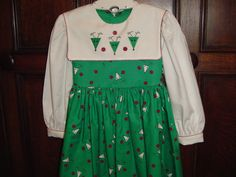 Basic Square Yoke dress with a square collar (it is not a jumper!).  Applique from Applique For Kids.  Reindeer fabric from Fabric Finders