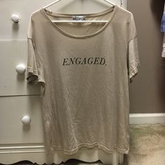 Wildfox Engaged Tee Purchased & never wore. I'm no longer engaged so I can't wear it. Previous owner wore it twice. Mint condition. Size 1 which is XS/S (it's unisex). Just trying to make back what I spent. I am accepting trades on this item. Wildfox Tops Tees - Short Sleeve