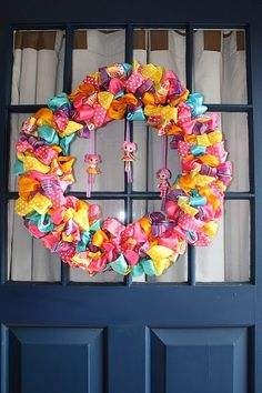 "Lalaloopsy ""Wreath"" - made from multicolor polka dot bows. Fasten these to a hoop and finish with a few mini-Lalaloopsy dolls!"