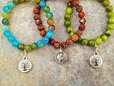 Yoga Inspired Handcrafted Bracelets Feature Harmony | Stones in Harmony. From left to right: Blue Agate, Matte Fire Agate and Green Agate, all grounding gemstones which put the body, mind and spirit in harmony.