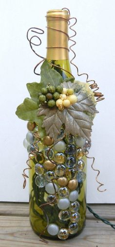 Decorative Embellished Wine Bottle Light with Leaves, Berries, and Gold Glass Gems. $20.00, via Etsy.
