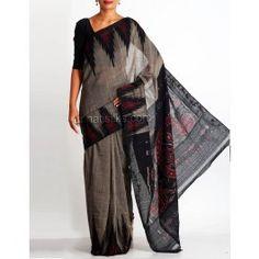 'Grey color pure handloom Pochampally cotton saree without blouse.This plain cotton sari has got black, maroon ikkat tie