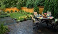 Backyard Patio with sitting area and large yard for the kids to play in.