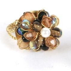 Black and cream glass bead ring with brass detail, handmade by Fair Trade artisans in India.