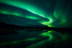 Northern lights (Aurora borealis) reflection across a lake in Iceland blurays: http://www.blu-ray.com/movies/top.php - Green