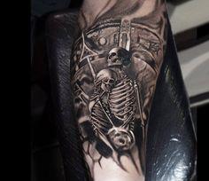 Skull tattoo by Jurgis Mikalauskas Tattoo