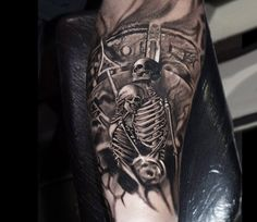 Skull tattoo by Jurgis Mikalauskas Tattoo