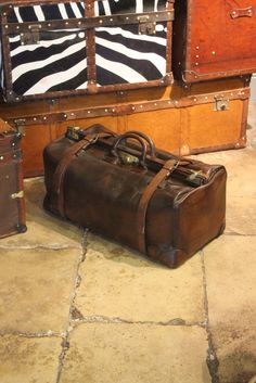 A charming 1920s leather belted gladstone bag.