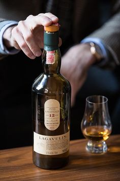 A comparison of Lagavulin 12 year old scotch and Lagavulin 16 year old scotch. Whisky Bar, Cigars And Whiskey, Malt Whisky, Scotch Whiskey, Bourbon Whiskey, Whiskey Bottle, Peach Drinks, Fun Drinks, Alcoholic Drinks