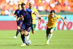 Oar challenges van Persie | Robin van Persie of the Netherlands controls the ball against Tommy Oar of Australia during the 2014 FIFA World Cup Group B match at Estadio Beira-Rio on June 18, 2014 in Porto Alegre, Brazil.
