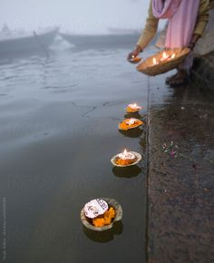 hinduism religious ceremony puja flowers and candle on Ganges water, India