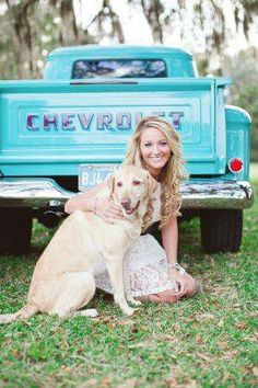 A girl, her dog and her truck!