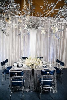 Silver, Sapphire & Sequin #Wedding Decor I Carmen Salazar Photography I See more: http://www.weddingwire.com/wedding-photos/i/winter-country-club-historic-site-modern-space-museum-hollywood-glam-modern-style-ballroom-city-silver-indoor-reception-avant-garde-chairs-tablescape-formal-blue-hip/i/9e6af3a1025f2b44-3a25108a21a78559/90d81f58a02dd8a2?tags=modern-style&page=3&cat=reception&type=search