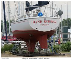 The sailboat Bank Robber set up on boat jacks at an Eastport boatyard in Annapolis Maryland. Photograph published on August 1st 2014. To see a full size version of this photograph and the Annapolis Experience Blog article click on the Visit Site button. Image and article Copyright © 2014 G J Gibson Photography LLC.