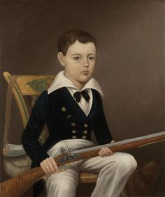 """""""Portrait of Hugh Gibson Glenn with Flintlock Rifle"""" features a bright-eyed young boy, perhaps five or six years of age, seated in a wooden chair against a flat gray-brown background. Dressed in a dapper blue jacket with gold buttons, black bow tie, and white shirt and breeches, he holds a rifle prominently in his lap. The head of a dog appears at profile in the lower right-hand corner of the composition, while a powder horn hangs from the chair at the extreme left. Artist unknown."""