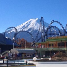 """Fuji-Q Highland is a theme park near the base of Mt. Fuji. In """"The Amazing Race"""" S9, a roadblock required one team member to ride on three extreme rides in the Fujikyu Highland Amusement Park in the following order: The Pizza, Dodonpa, and Fujiyama. While riding the rides, they had to look for a man holding a sign. Upon completion of their third ride, they had to tell the park manager what was written on the sign to receive their next clue. If they didn't see the sign they would have to go…"""